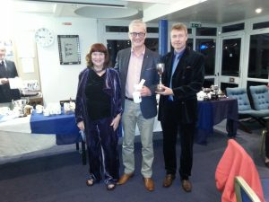 Nicola Colley with Trophy winners Richard Mourant and Joe Woods
