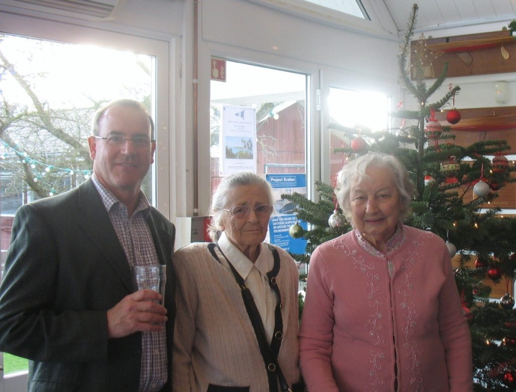 Marcus Chavasse, Peggy Morris and Angela Norris with the Christmas tree