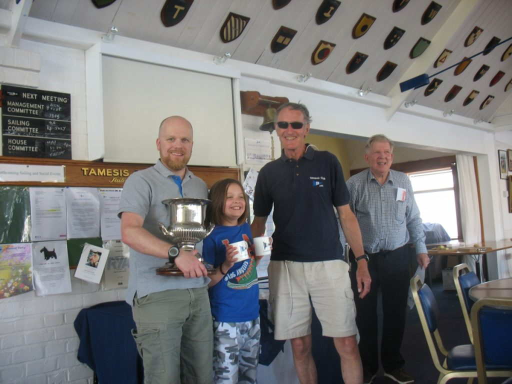 Commodore Colley presents the Centenary Cup to Rob and Milly