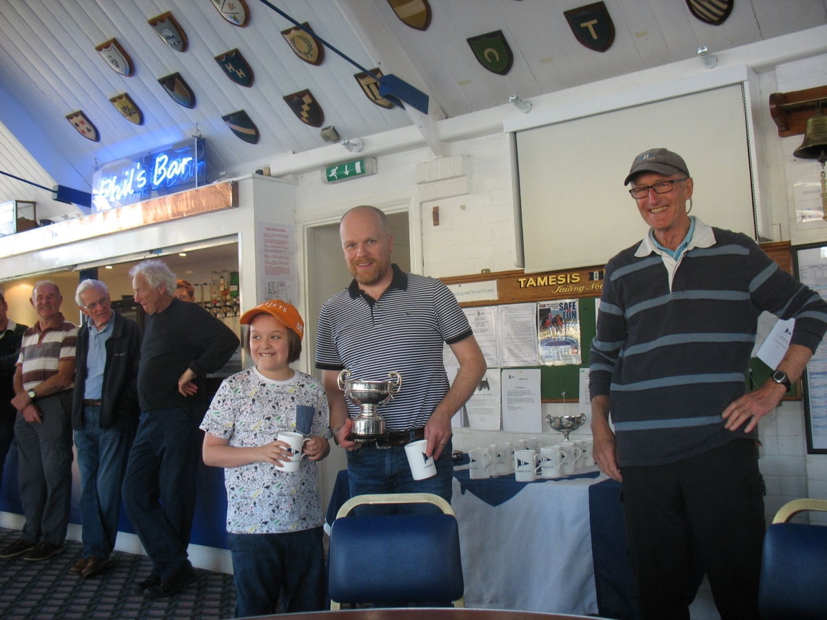 Commodore Colley presents the Porteous Cup to Rob and Milly Wilder