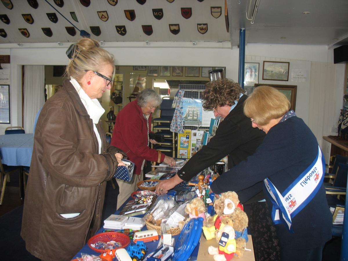 Tamesis members buy Christmas gifts at the RNLI stall